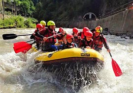 A group of people having fun rafting down the river on their Fun Rafting on the Salzach River with Torrent Outdoor Experience.