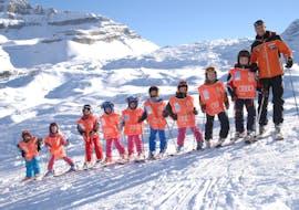 Children take ski lessons