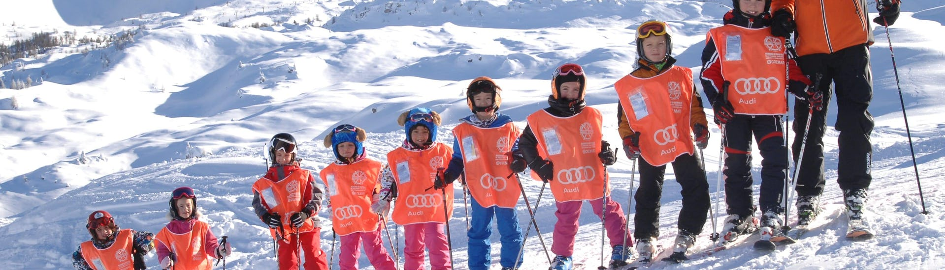 Children take ski lessons