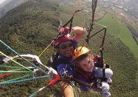 "A kid is enjoying the Tandem Paragliding ""Discovery Kids"" - Millau activity with Air Magic Parapente."