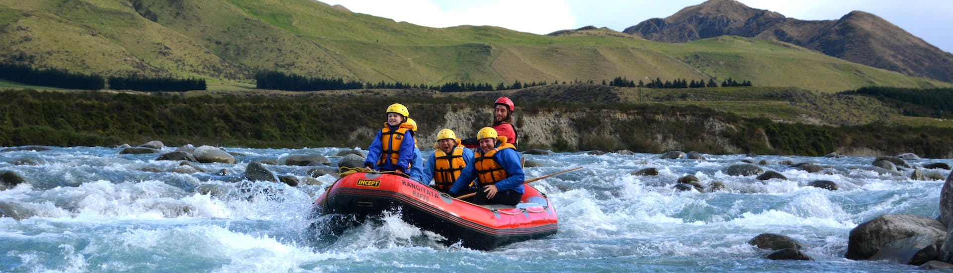 A family is having fun on the river during their Grade 2 Rafting Adventure on Lower Rangitata River organized by Rangitaiki Rafts.