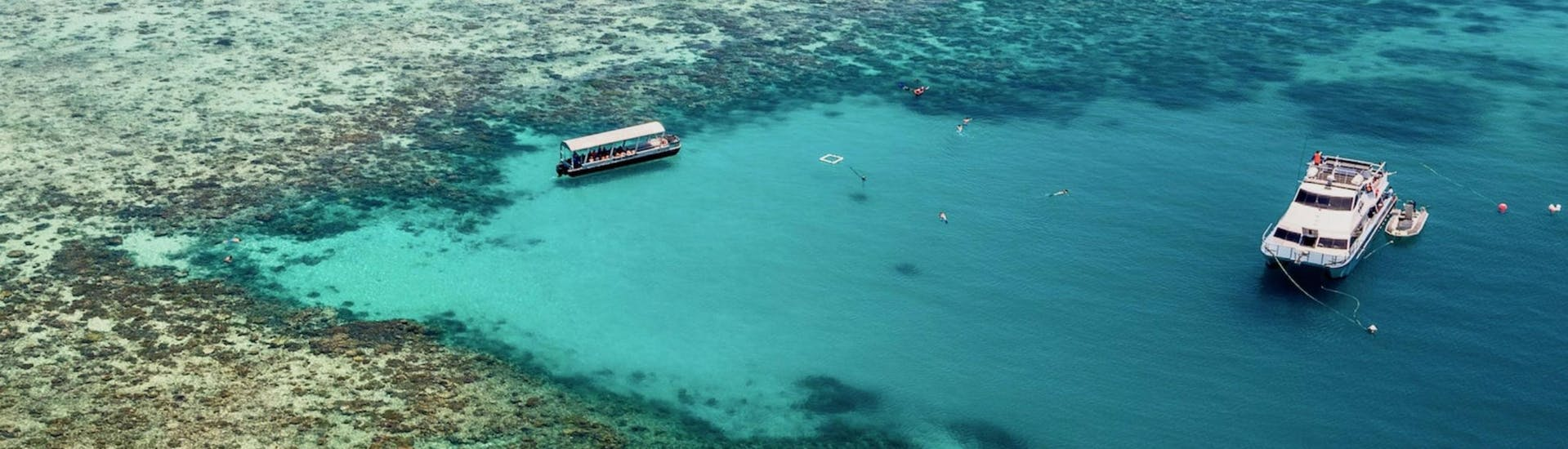 The Ocean Freedom catamaran is moored on theedge of Upolu Reef, where guests can go snorkeling during the Great Barrier Reef Cruise from Cairns.