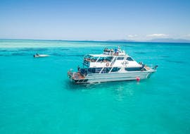 The Ocean Freedom catamaran is anchored in the shallow waters around Upolu Cay during the Great Barrier Reef Cruise from Cairns.