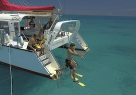 During the Great Barrier Reef Snorkeling Trip from Cairns with Reef Daytripper Cairns, snorkelers are jumping into the clear, warm water to explore the underwater world of Upolu Reef.