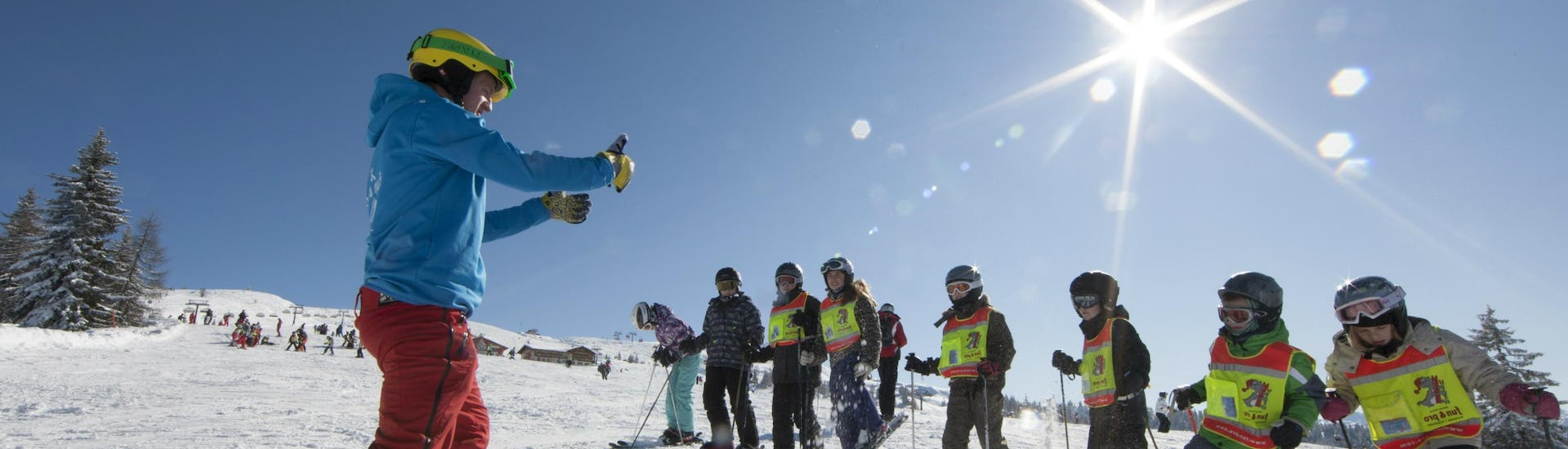 A ski instructor is holding one of the many group ski lessons in the ski resort of La Toussuire.