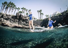 Two participants enjoying the guided SUP tour in Puerto del Carmen with Surf&SUP School3s Lanzarote.