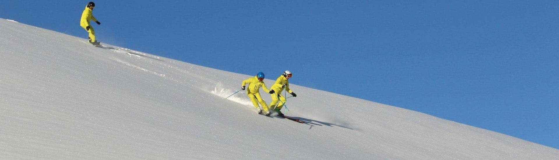 People descend the slopes of Val Gardena
