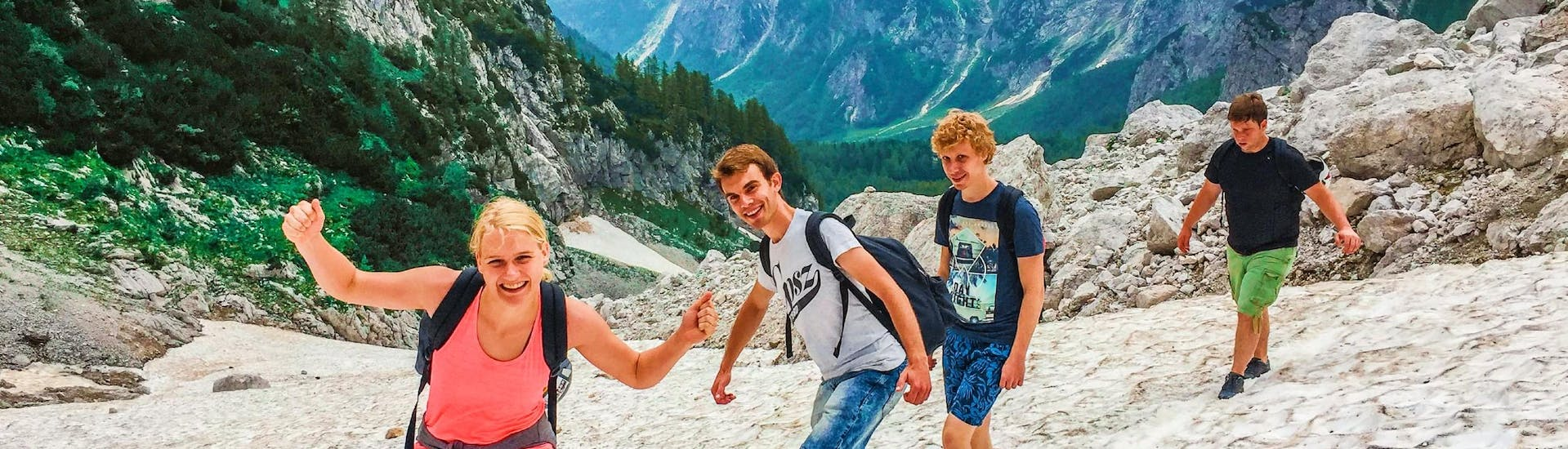 A group of friends is having fun during the Guided Hike to the Top of Raduha Mountain (2062m) with Funpark Menina.