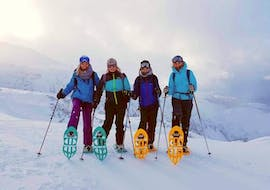 A group of friends is taking a picture together during on of the guided snowshoeing tours on the Untersberg mountain organized by Bergführer Salzburg.
