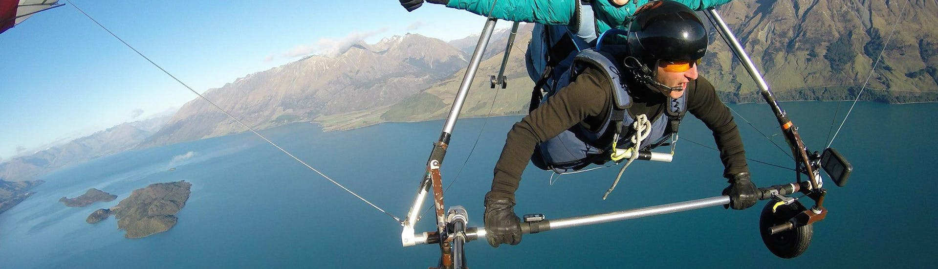 A hang gliding passenger is seemingly enjoying herself while Aerotow Hang Gliding in Queenstown with Skytrek Queenstown.
