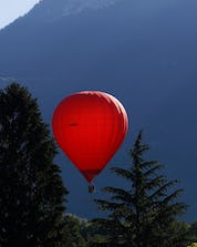 A beautiful mountain scenery that can be admired during a hot air balloon flight over Lake Annecy in France.
