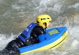 A person is participating in a Hydrospeed on Dranse River - Discovery activity with AN Rafting Haute-Savoie.