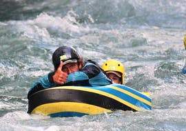 A man is enjoying hydrospeed on the Haute-Isère river with AN Rafting Savoie.