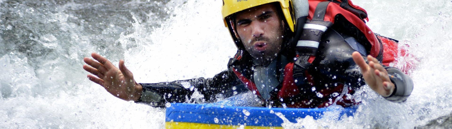 A man is on a hydrospeed on the nive with Cocktail Aventure.