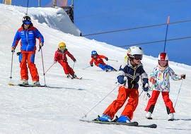 Cours de ski Enfants (4-15 ans) pour Tous niveaux avec Tzoum'Évasion