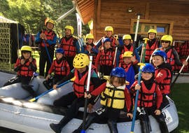 A family is having fun during the Rafting on Durance River for Families activity with Ecrins Eaux Vives.