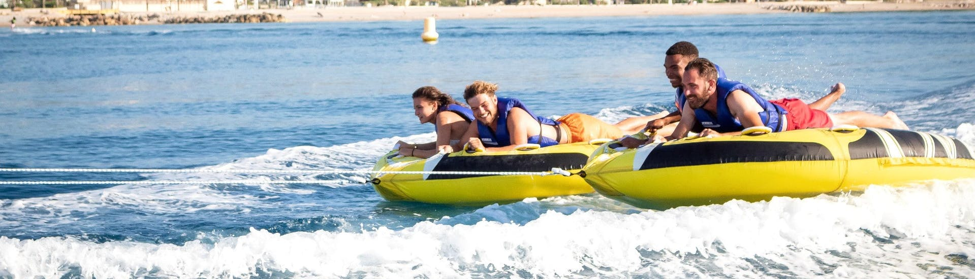 Friends are having fun on their ride with an Inflatable Boat in Villeneuve-Loubet with Plage des Marines.