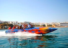 "A group of vacationers enjoying the wild manoeuvres on their Jet Boat Ride ""Ocean Rocket"" off the coast of Albufeira together with an experienced captain from Dream Wave."