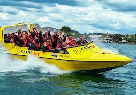 A group of people enjoying themselves while Jet Boating in Rotorua with Katoa Lake Rotorua.
