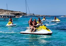 A group of friends is having fun and enjoying the breathtaking view of the Maltese coastline while driving Jet Ski at Mellieha Bay with Oh Yeah Malta.