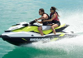 Two persons ride a jet ski from Corfu Ski Club in Daphnila Beach.