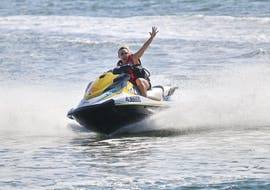 A girl is experiencing a thrilling ride during the Jet Ski in Gold Coast - 1,5h Tour, organised by Gold Coast Watersports.