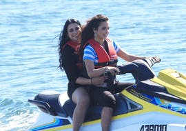 Two girls are enjoying their holidays while riding a powerful jet ski during the Jet Ski in Gold Coast - 2h Tour organised by Gold Coast Watersports.