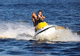 A couple is having fun while exploring the surroundings of Malta during a Jet Ski Safari to Comino & Blue Lagoon with Oh Yeah Malta.