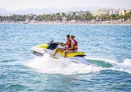 Two friends enjoy the Jet Ski Tour in the pleasant sea together with Estació Nàutica Costa Daurada during the Jet Ski Tour at Playa de Levante.