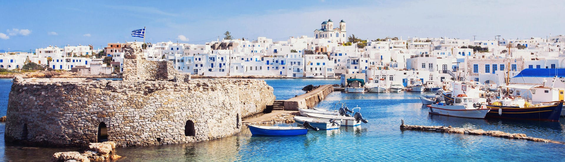 An image of Naxos port, a popular destination for people who want to do water sports in Greece.