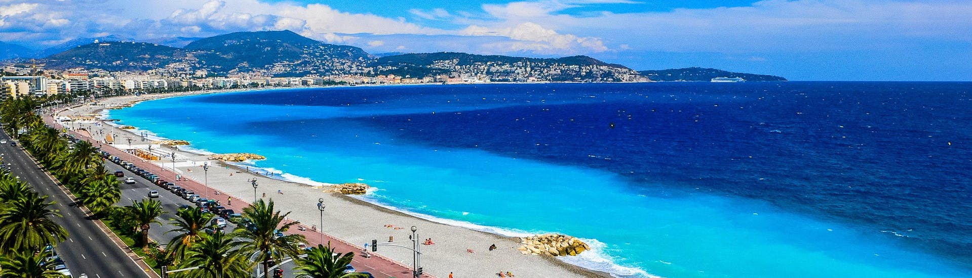 An image of the beautiful beach promenade and the deep blue waters of the Côte d'Azur you get to see when riding a jet ski or doing other water sports activities in Nice.