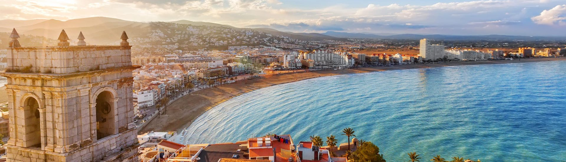 An image of the beatiful beachfront you get to see when riding a jet ski or doing other water sports activities in Valencia.