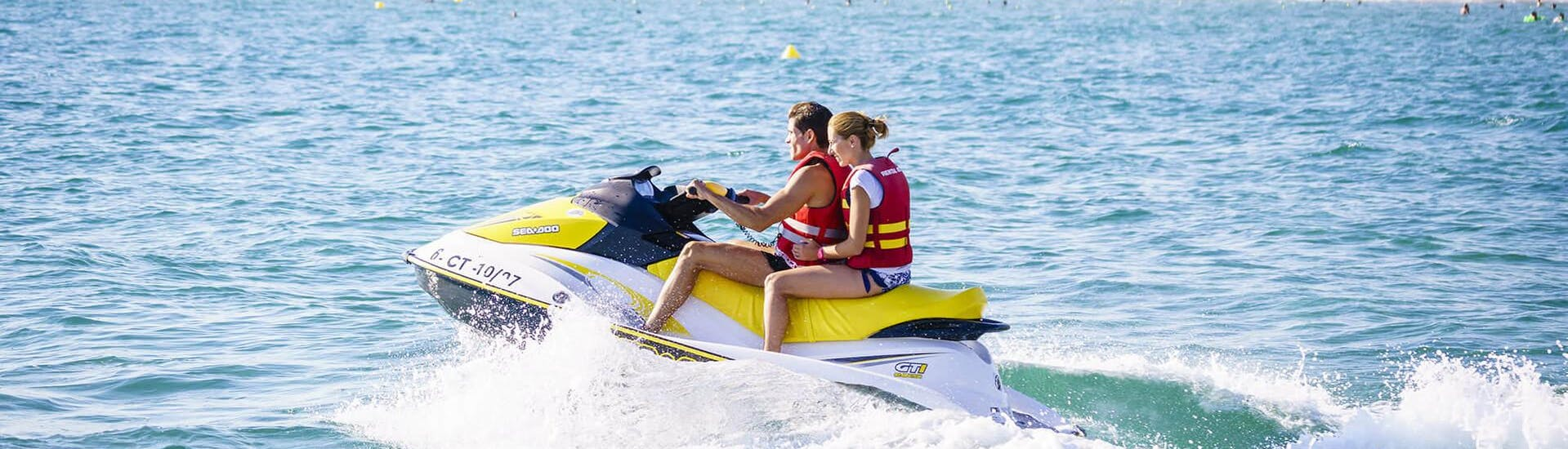 Two friends enjoy the jet ski tour in the pleasant sea together with Estació Nàutica Costa Daurada during the Jet Ski Rental in Salou or Cambrils.