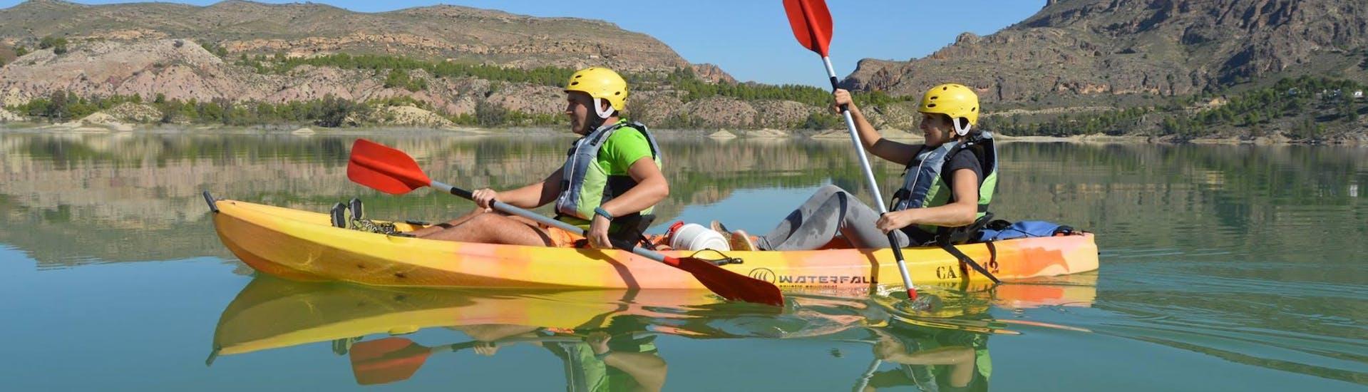 Two friends paddle in a kayak to Cañón de Almadenes on the Rio Segura with Cañón y Cañón Multiaventura.