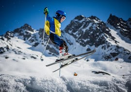 """Child makes a high jump during the Private Ski Lessons for Kids """"Full Day"""" - All Ages with the ski school European Snowsports Chamonix."""