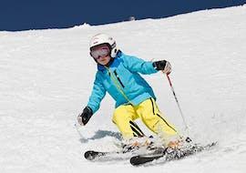 Kid slides down slope