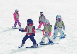 A group of children aged 4-6 enjoy a ski lesson at Baqueria with Mammut Ski School.