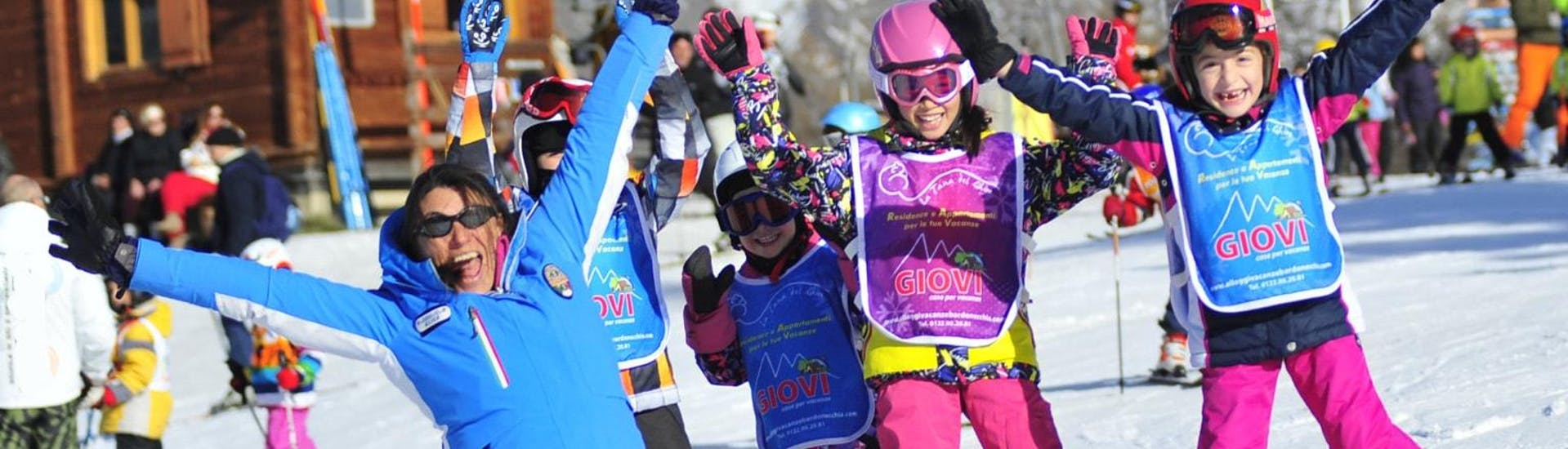 Kids are playing games and learn how to ski with their new friends in the Kids Ski Lessons (4-14 y.) - Low Season - Advanced under the supervision of an experienced ski instructor from the ski school Scuola di Sci Bardonecchia.