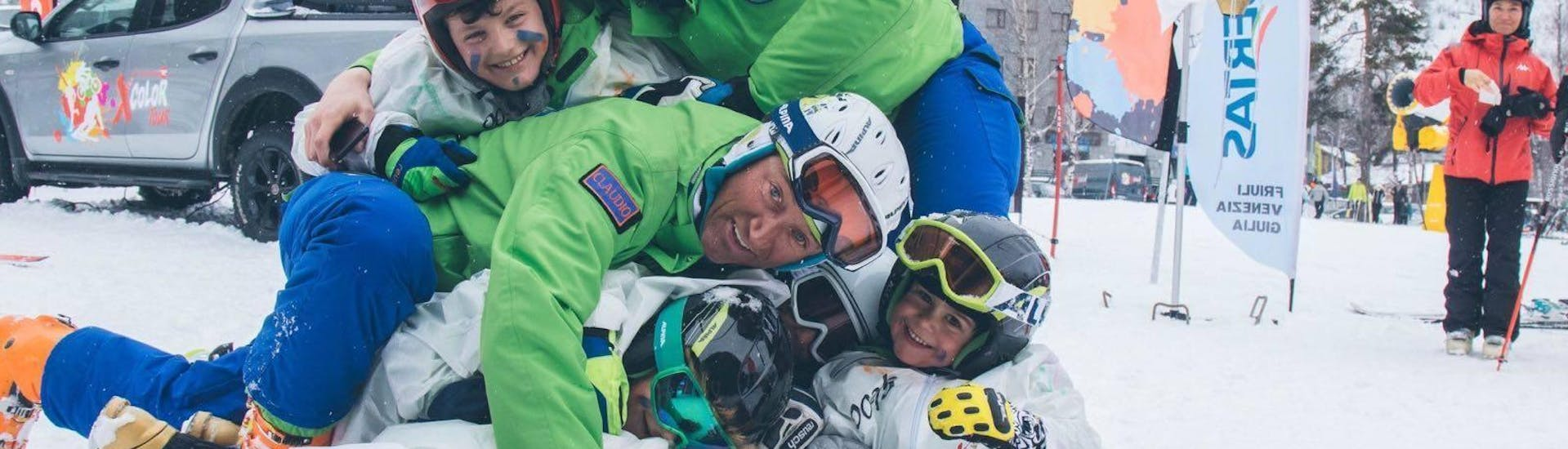 During the Kids Ski Lessons (4-8 y.) - All Levels - Christmas, children are having fun with a ski instructor from the ski school Scuola di Sci B.foxes.