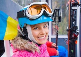 A girl is happy to start the kids ski lessons 9-14 years - all levels in the Schneesportschule Thoma.