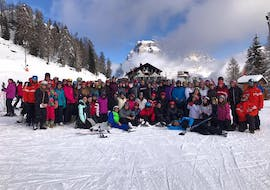 The Kids Ski Lessons (5-12 y.) - Christmas - All Levels are about to begin, the children get to know the ski instructor of the Ski School Scuola Italiana di Sci Civetta.