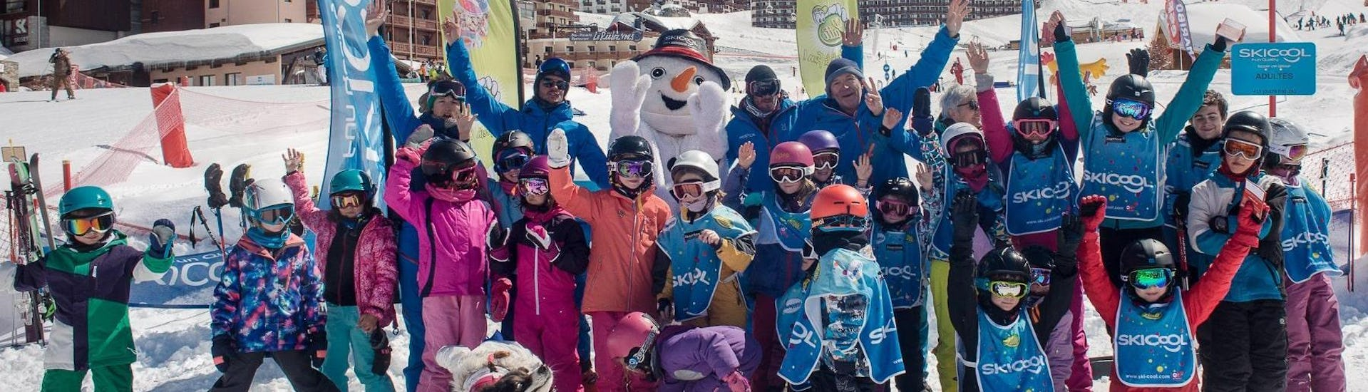 A group of kids is excited to start their ski lessons with the ski school Ski Cool in the ski resort of Val Thorens.