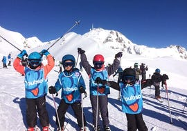 Young skiers are standing in front of a snow-covered mountain ready for their Kids Ski Lessons (5-13 ans) - Afternoon with the ski school ESI du Tourmalet in La Mongie.