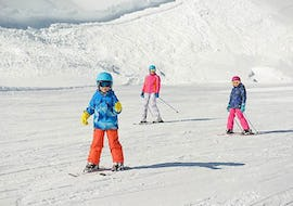 A group of children is learning to ski during Kids Ski Lessons (5-15 years) in the Afternoon for First Timers with the ski school Kahler Asten.