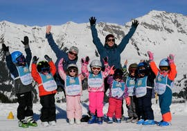 Kids are happy to learn to ski during their Kids Ski Lessons (5-16 years) - All Levels with the ski school Diablerets Pure Trace.