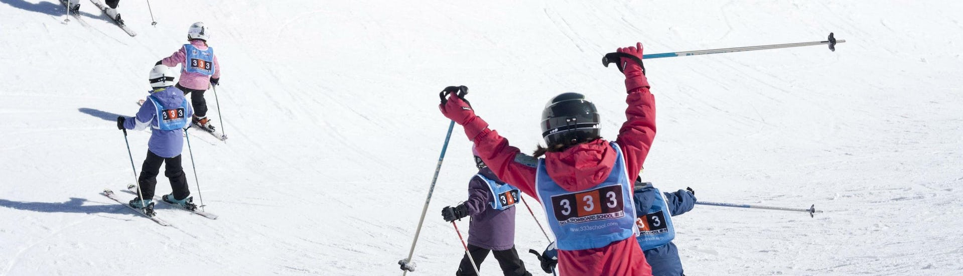 A group of kids enjoying their Kids Ski Lessons (5-17 years) - Morning - All Levels with the ski school 333 Ski School in the ski resort of Tignes.