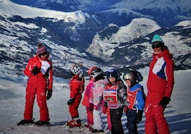 Kids are standing at the top of the slope ready to start their Kids Ski Lessons (6-12 years) - February - Morning -Beginner with the ski school ESF du Dévoluy.