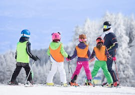 A group of children is preparing to ski during the kids ski lessons (6-17 years old) for young with experience held by the Ski School Abetone.