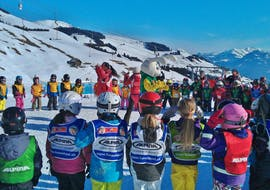 Kids are gathered before the start of their Kids Ski Lessons (from 4 years) - All Levels with the ski school Swiss Ski School Les Crosets-Champoussin.