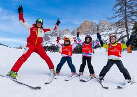 Kids and their ski instructor from Carezza Skischool are on the slopes during Kids Ski Lessons (from 4 years) - Beginner.